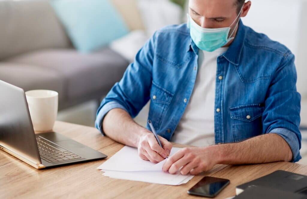 Man filling some documents during home office