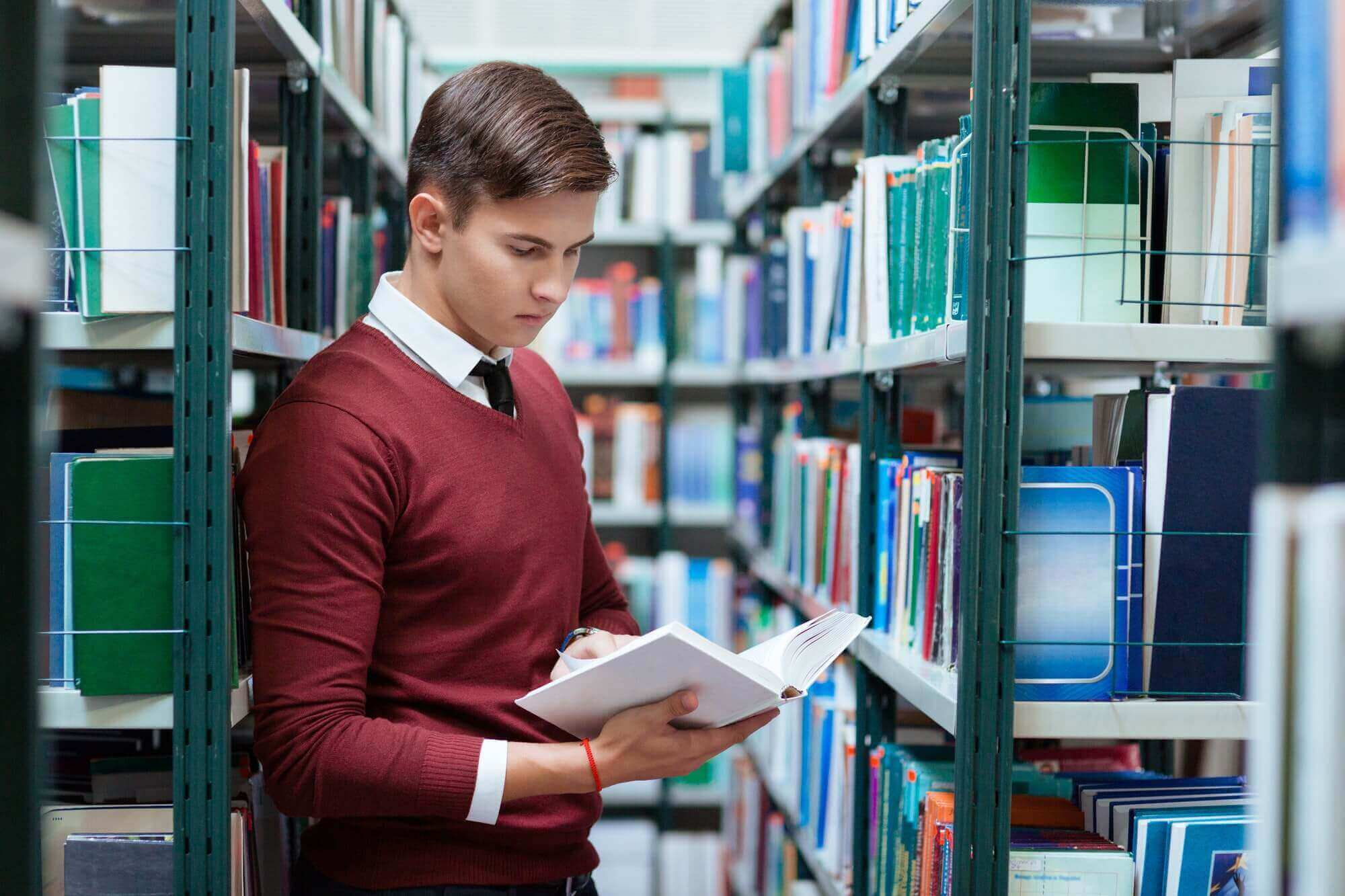 Student searching book in university library