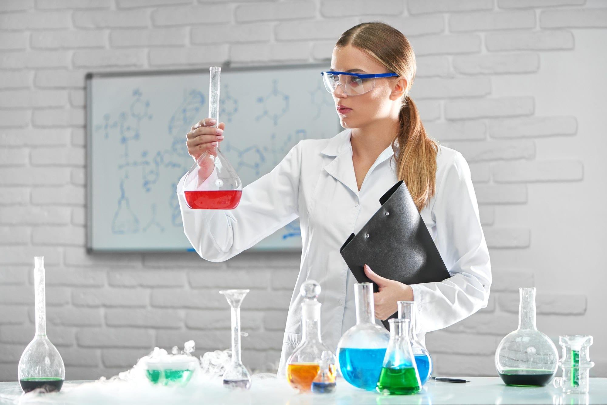 Female chemist working at the laboratory