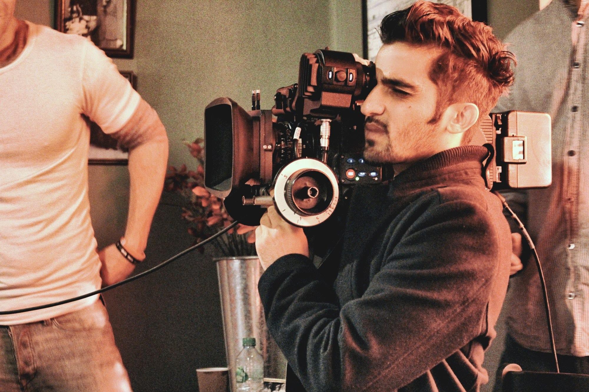 Filmmaker holding Arri Alexa film camera, filming a short film