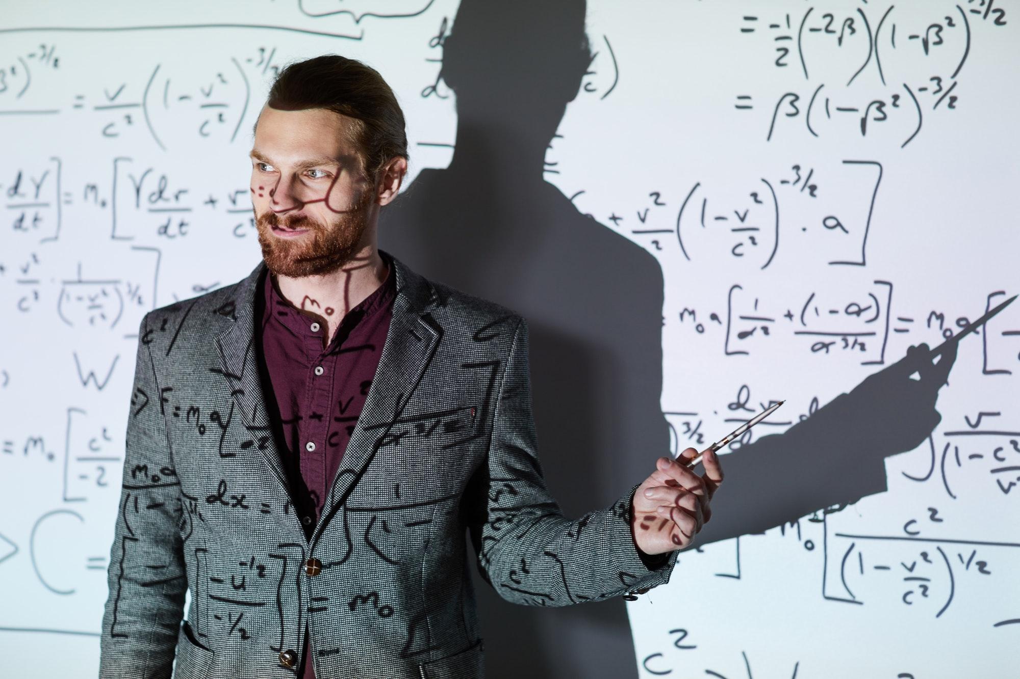 Math teacher explaining calculations